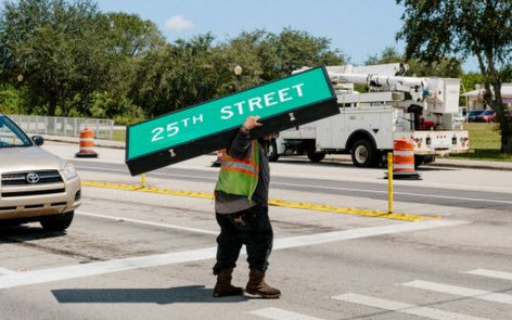 Hurricane Irma Preparation: A worker removed a road sign in Fort Pierce FL